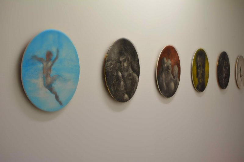 Discs, oil on board, painted by artist Robert Stuart, hanging outside his studio